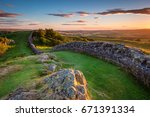 hadrian's wall near sunset at... | Shutterstock . vector #671391334