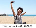 portrait of smiling young afro... | Shutterstock . vector #671408821