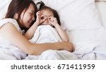 mom and baby.  | Shutterstock . vector #671411959