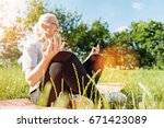 peaceful aged woman practicing... | Shutterstock . vector #671423089