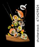 sushi pieces placed between... | Shutterstock . vector #671429824