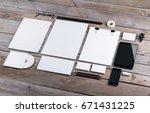 photo of branding identity mock ... | Shutterstock . vector #671431225
