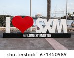 Small photo of MARIGOT-AUGUST !: Sign and statue I love St Martin in Marigot, seen in Marigot , St.Marten on August 1, 2015