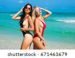 two beautiful amazing tanned... | Shutterstock . vector #671463679
