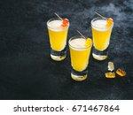 three bright yellow cocktail... | Shutterstock . vector #671467864