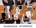 business meeting top view.... | Shutterstock . vector #671469421