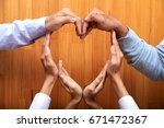 people making heart shape with... | Shutterstock . vector #671472367