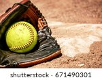 Softball And Glove In Front Of...