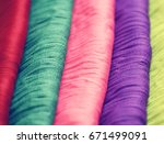 stack of colorful clothes | Shutterstock . vector #671499091