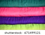 stack of colorful clothes | Shutterstock . vector #671499121