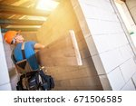 construction worker with large... | Shutterstock . vector #671506585