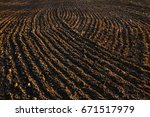 black soil plowed field. earth... | Shutterstock . vector #671517979