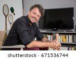 45 year old man relaxing in... | Shutterstock . vector #671536744