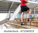 close up leg of businesswoman... | Shutterstock . vector #671560315