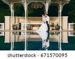 wedding couple on a walk | Shutterstock . vector #671570095