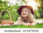 little girl playing and eating... | Shutterstock . vector #671575255