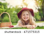 little girl playing and eating... | Shutterstock . vector #671575315