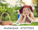 little girl playing and eating... | Shutterstock . vector #671575321