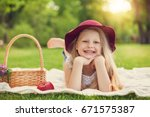 little girl playing and eating... | Shutterstock . vector #671575387