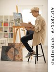 teenage painter painting on a... | Shutterstock . vector #671587519