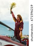 Small photo of Russia, Perm, 24 June 2017. Parma Wings Festival in airfield. Svetlana Kapanina seven-time absolute world champion in aerobatics, sports aviation. included in the Guinness Book of Records. Extra 330LC