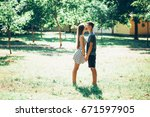 adorable couple on a sunny day... | Shutterstock . vector #671597905