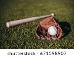 baseball bat  ball and glove is ... | Shutterstock . vector #671598907
