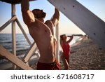 the guy pulls up on the beach.... | Shutterstock . vector #671608717
