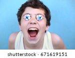 teenager boy with jujube... | Shutterstock . vector #671619151