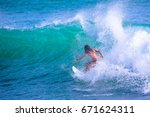 riding the waves. costa rica ... | Shutterstock . vector #671624311