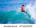 riding the waves. costa rica ... | Shutterstock . vector #671624335