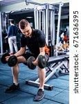 handsome sportive man in... | Shutterstock . vector #671636395