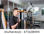 young man working out and doing ... | Shutterstock . vector #671638444