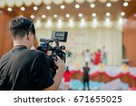 covering an event on stage with ... | Shutterstock . vector #671655025