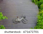 Small photo of Vintage bicycle on wooden floor at Sri Nakhon Khuean Khan Park and Botanical Garden. Bang krachao, Phra Pradaeng, Samut Prakan, Thailand