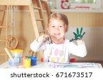 happy little girl with hand in... | Shutterstock . vector #671673517