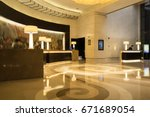 Stock photo hotel lobby interior with reception desk marble floor and crystal lamp 671689054