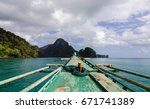 a wooden boat on the sea near...   Shutterstock . vector #671741389