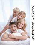 a happy family on a bed in the... | Shutterstock . vector #67174927