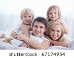 a family with two children on a ... | Shutterstock . vector #67174954