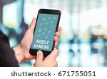 hand holding mobile with mobile ... | Shutterstock . vector #671755051