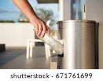hand putting plastic bottle... | Shutterstock . vector #671761699