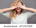 curly haired blonde smiling... | Shutterstock . vector #671767309