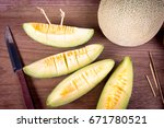 fresh melons sliced on wooden... | Shutterstock . vector #671780521