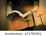 a man reading the holy bible. | Shutterstock . vector #671785351