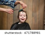 a little boy is trimmed in the... | Shutterstock . vector #671788981