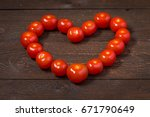 tomatoes on wooden table in... | Shutterstock . vector #671790649