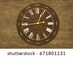 vintage wall clock on the wood... | Shutterstock . vector #671801131