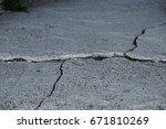 damaged asphalt road with... | Shutterstock . vector #671810269