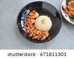 rice and shrimp fried with... | Shutterstock . vector #671811301